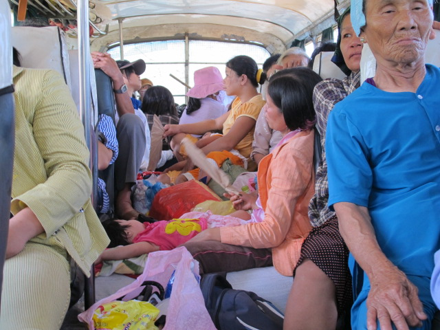 Inside the bus, some passengers even sat on the goods packed on the aisle.