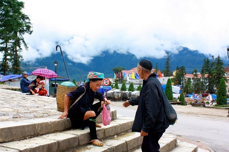An elderly couple in front of Nhà Thờ Đá (Sapa's stone church)