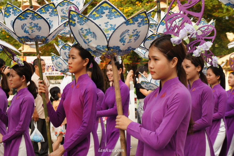 Girls in áo dài at a festival